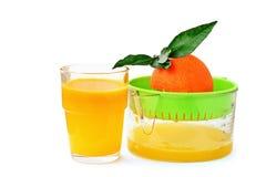Squeezing orange juice Royalty Free Stock Photos