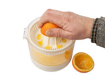 Squeezing orange Stock Image
