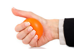 Squeezing an orange stress ball Royalty Free Stock Photo