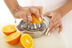 Squeezing oranges. Close-up scene of squeezing oranges stock photography