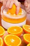 Squeezing oranges Stock Images