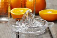 Squeezing oranges Stock Images