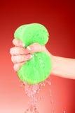 Squeezing sponge Royalty Free Stock Photo