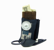 Squeezing Wallet With Blood Pressure Cuff. Blood Pressure cuff squeezing wallet symbolic of a money crunch Stock Photography