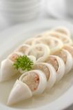 Squid. A plate of squid with lemon royalty free stock photo