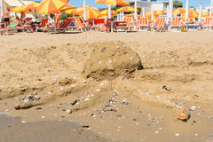 Squid as sand figure on beach Royalty Free Stock Images