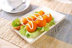 Squid ball. In slices in the white disk Royalty Free Stock Photos