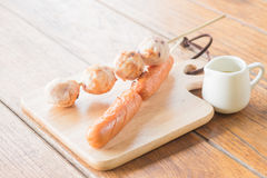 Squid ball and hotdog grilled on wooden plate Stock Image