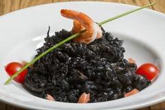 Squid in black ink sauce Stock Images