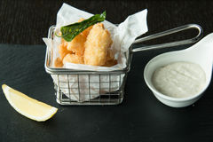 Squid and chips on a basket Stock Photo