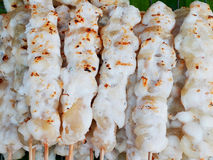Squid eggs. Grilled squid eggs are plugged into wooden skewers Royalty Free Stock Photos