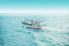Squid fishing boat early in the morning in the open sea - Jeju island, Korea. Squid fishing boat early in the morning in the sea - Jeju island, Korean Republic Royalty Free Stock Image