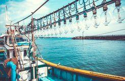 Squid fishing boat entering port in the morning - Jeju island, South Korea. Squid fishing boat entering port - Jeju island, South Korea Royalty Free Stock Image