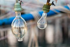 Squid fishing boat light bulb Stock Images