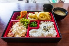 Squid fried bento set on the table ready to serve. Japanese food style. Stock Photos