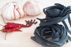 Squid ink black tinted twirl of a tagliatelle Royalty Free Stock Photography