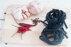 Squid ink black tinted twirl of a tagliatelle Royalty Free Stock Photos