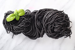 Squid ink homemade pasta on marble Stock Photo