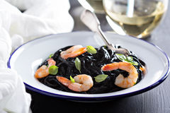 Squid ink homemade pasta with shrimp Stock Images