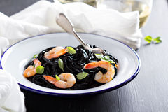 Squid ink homemade pasta with shrimp Stock Photos