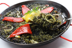 Squid ink paella Royalty Free Stock Photos