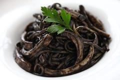Squid ink pasta Stock Images