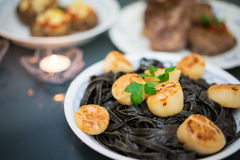 Squid lnk Pasta with Scallops Royalty Free Stock Photos
