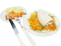 Squid meal with carrot salad and shimps Royalty Free Stock Images