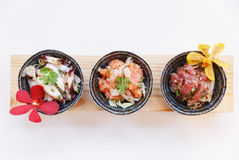 Squid, Raw Salmon and Maguro Bluefin Tuna Spicy Salad Served in Stone Bowl Royalty Free Stock Photography