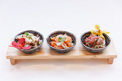 Squid, Raw Salmon and Maguro Bluefin Tuna Spicy Salad Served in Stone Bowl Stock Photography