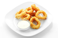 Squid rings in batter, sauce Royalty Free Stock Images