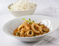 Squid rings. Cooked in a tasty sauce served with rice Stock Photo