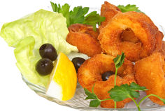 Squid rings. Deep fried with lemon, olives and fresh herbs Stock Photos