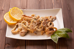 Squid rings gratin Stock Image
