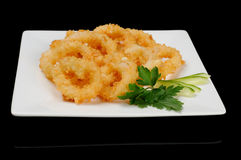 Squid rings. Served on white plate in the japanese restaurant Royalty Free Stock Photography