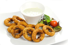 Squid rings with vegetables and salad Royalty Free Stock Photo