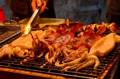 Grilled squid. The squid is roasting in the night market royalty free stock photos