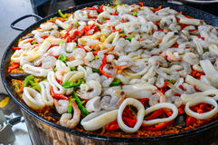 Squid and scallions paella Stock Photos
