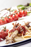 Squid, spagetti and homemade tomato sauce Royalty Free Stock Photos