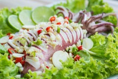 Squid steamed with lime. Thai food , hot and spicy Royalty Free Stock Photo