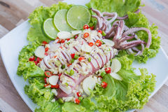Squid steamed with lime. Thai food , hot and spicy Stock Image