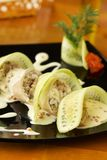 Squid stuffed with rice and seafood under caviar sauce Royalty Free Stock Photography
