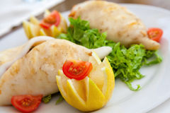 Squid stuffed with seafood on white plate Stock Image