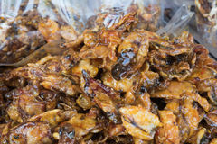 Squid. Sweet and spicy dried squid on the market  Thai style crispy fried squid Stock Photo