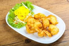 Squid tempura. Asian style cuisine on wood background stock photo