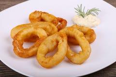 Squid Tempura. Hot crispy Squid tempura with garlic sauce stock image