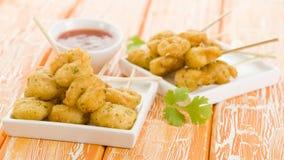 Squid Tempura Skewers. Battered and deep fried calamari on skewers. Served with mango dip Royalty Free Stock Images