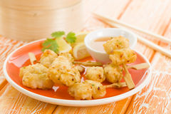 Squid Tempura Skewers. Battered and deep fried calamari on skewers. Served with mango dip Royalty Free Stock Photos