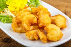 Squid tempura. Asian style cuisine on wood background royalty free stock photo