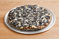 Squid Thin Crust Pizza_2013-11. Squid Thin Crust Pizza on a desk Stock Image